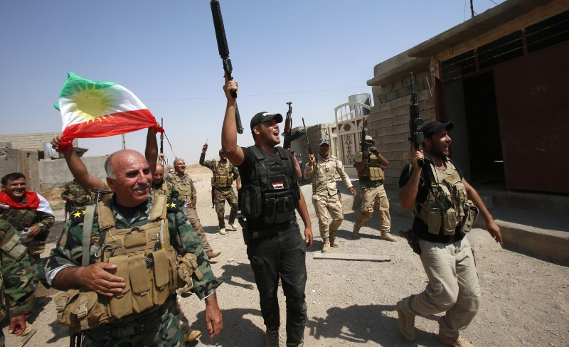 Divided Kurds fight the Islamic State