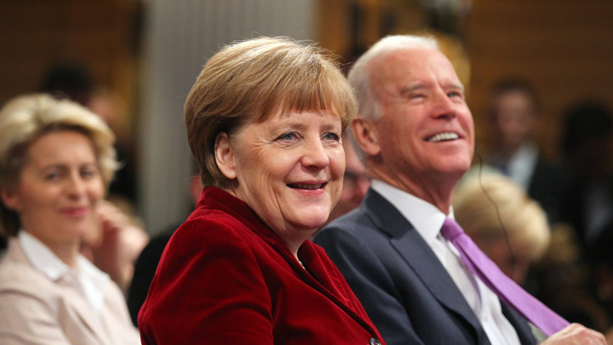 Joe Biden and Angela Merkel smiling at the Munich Security Conference