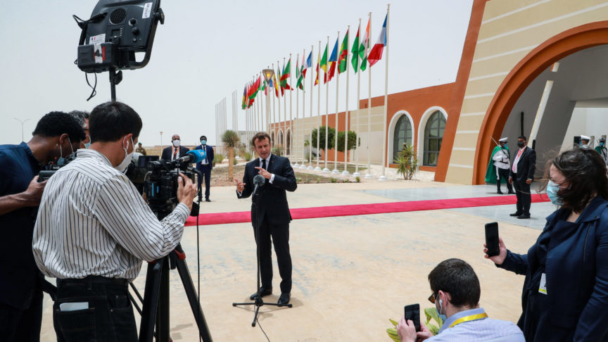 French President Emmanuel Macron speaks to the press upon arrival at Nouakchott Oumtounsy International Airport Tuesday June 30, 2020, in Nouakchott, to attend a G5 Sahel summit.  (Ludovic Marin, Pool via AP)