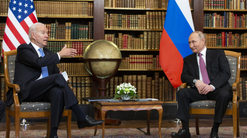 Presidents Biden and Putin are seated in a library during their summit in Geneva