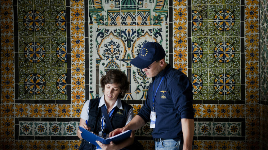 EU election observers in Tunisia stand in front of an ornate tile mosaic