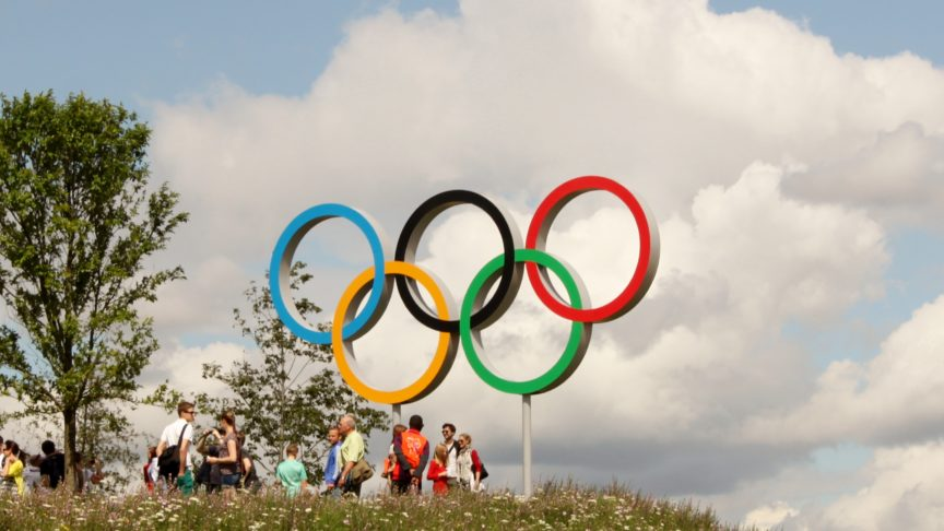 The five olympic rings above a hillside in England
